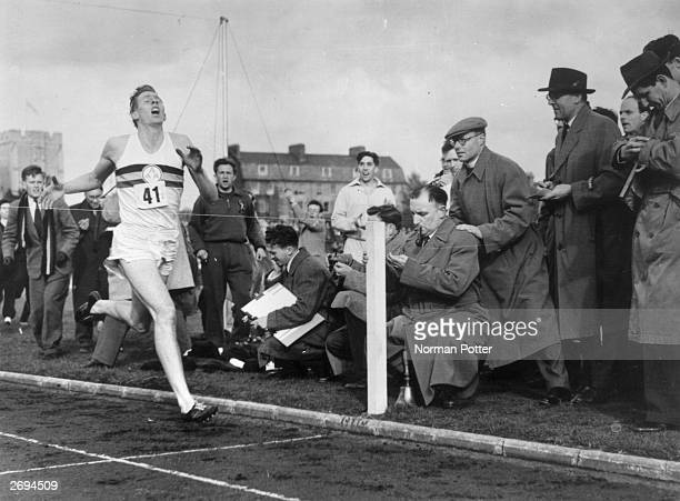 Roger Bannister about to cross the tape at the end of his record breaking mile run at Iffley Road Oxford He was the first person to run the mile in...