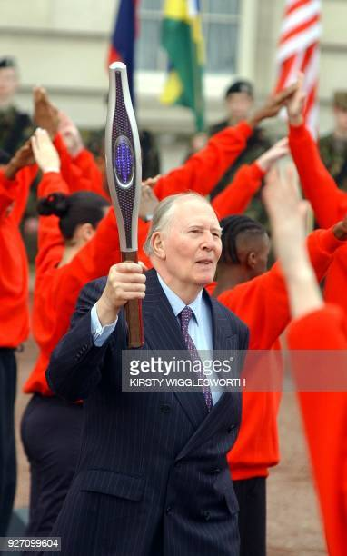 Roger Bannister holds the Commonwealth baton at the Commonwealth Day celebrations in the forecourt of Buckingham Palace in London 11 March 2002 In a...