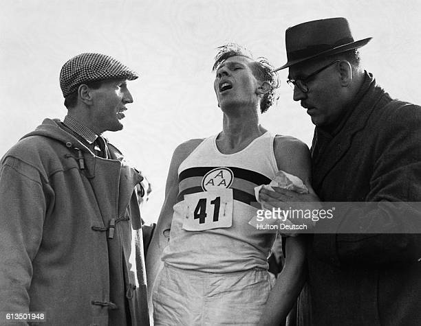 Roger Bannister just after his world record beating run at Oxford when he ran a mile in less than four minutes His time tonight was 3 min 594 sec |...
