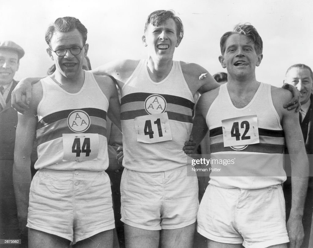 Roger Bannister (centre) with Chris Chataway (right) and Chris Brasher (1928 - 2003) after Bannister broke the mile world record with a time of 3 minutes and 59.4 seconds. The first time a mile has been run in under four minutes.