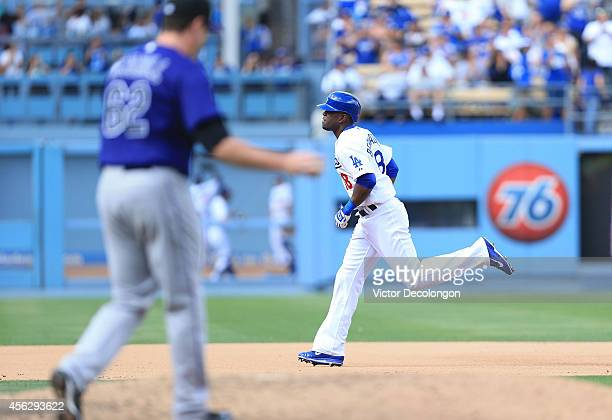 Roger Bernadina of the Los Angeles Dodgers runs to third base after hitting a threerun home run against pitcher Rob Scahill of the Colorado Rockies...