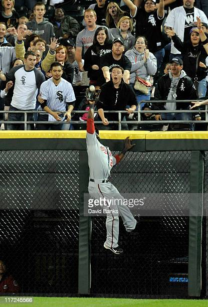 Roger Bernadina of the Washington Nationals robs Adam Dunn of the Chicago White Sox of a 2run homer in the sixth inning on June 24 2011 at US...