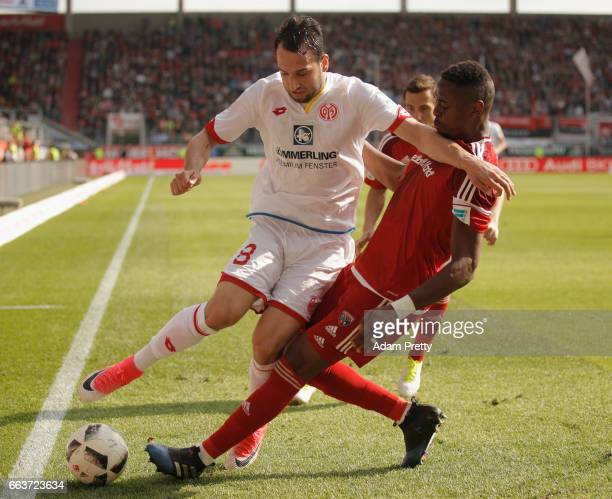 Roger Bernardo of Ingolstadt is challenged by Levin ztunali of Mainz during the Bundesliga match between FC Ingolstadt 04 and 1 FSV Mainz 05 at Audi...