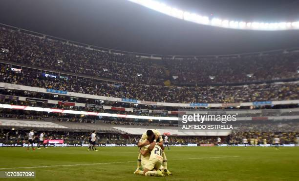 TOPSHOT Roger Beyker Martinez of America celebrates his goal against Pumas with his teammates during the second round of semifinals of the Mexican...
