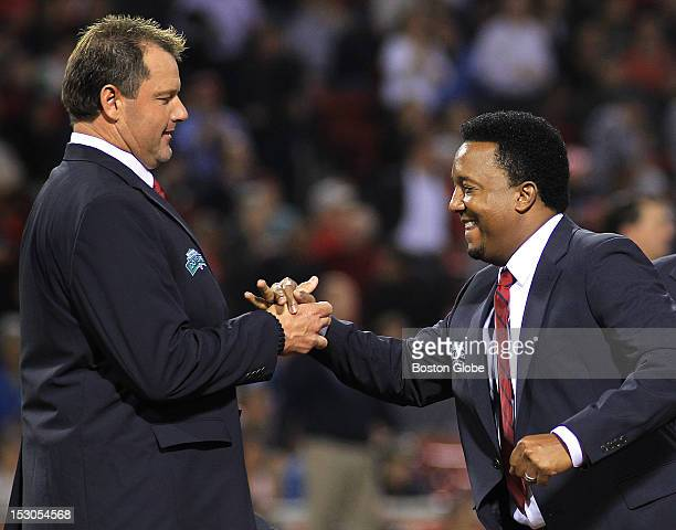 Roger Clemens left and Pedro Martinez greet each other as members of the All Fenway team are introduced on the field The All Fenway Park team is...