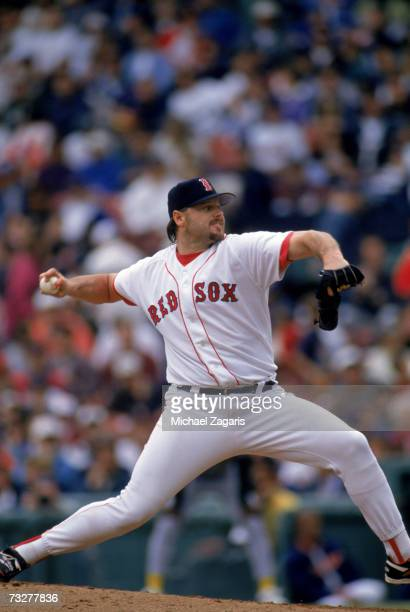 Roger Clemens of the Boston Red Sox delivers a pitch during a game against the Oakland Athletics at Fenway Park on May 18 1996 in Boston...