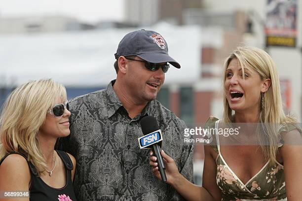 Roger Clemens of the Houston Astros and his wife Debbie are interviewed by Fox Sports reporter Carolyn Hughes on the All-Star Game Red Carpet during...