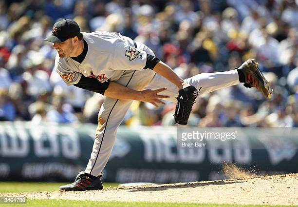 Roger Clemens of the Houston Astros delivers a pitch against the Colorado Rockies in the sixth inning on April 24 2004 at Coors Field in Denver...