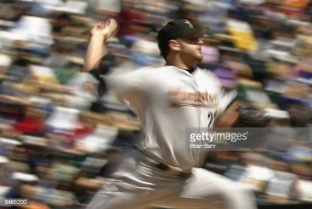Roger Clemens of the Houston Astros delivers a pitch against the Colorado Rockies in the second inning on April 24 2004 at Coors Field in Denver...
