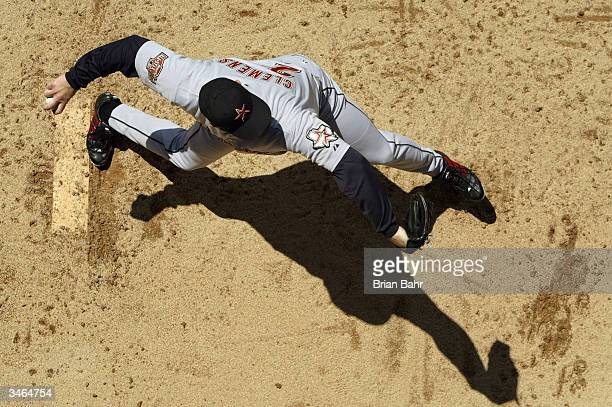 Roger Clemens of the Houston Astros warms up in the bullpen before a game against the Colorado Rockies at Coors Field on April 24 2004 in Denver...