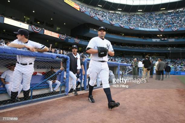 Roger Clemens of the New York Yankees walks to the bullpen prior to the American League Division Series game three against the Cleveland Indians at...