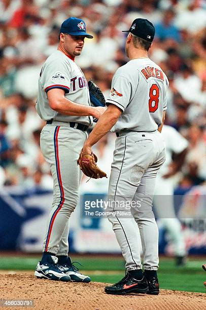 Roger Clemens of the Toronto Blue Jays and Cal Ripken Jr. Of the Baltimore Orioles during the All-Star Game on July 7, 1998 at Coors Field in Denver,...