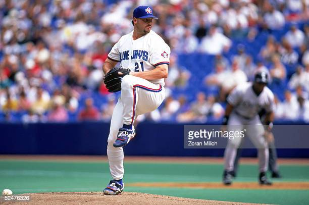Roger Clemens of the Toronto Blue Jays winds up for a pitch during a game against the Chicago White Sox at Toronto SkyDome on August 28 1997 in...