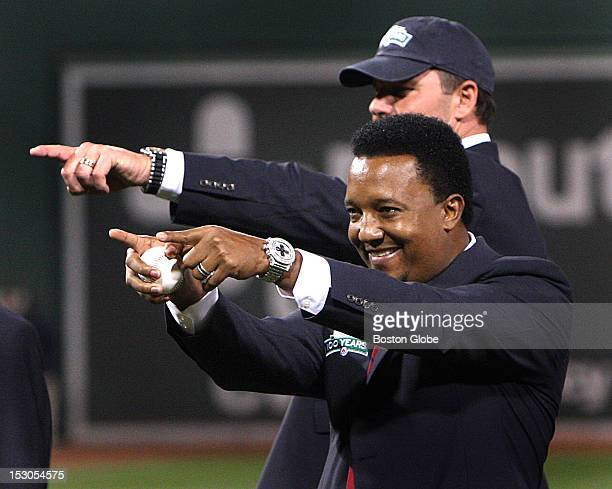 Roger Clemens rear and Pedro Martinez prepare to throw out the first pitches as members of the All Fenway team The All Fenway Park team is honored in...