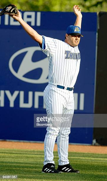 Roger Clemens seventime Cy Young Award winner who was recently acquired by the New York Yankees stretches before pitching for the AAA Trenton Thunder...