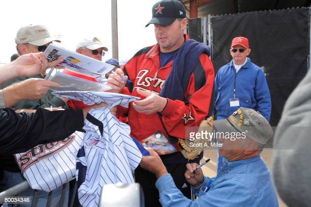 Roger Clemens signs autographs for fans at Houston Astros Spring Training at Osceola County Stadium on February 27 2008 in Kissimmee Florida The US...