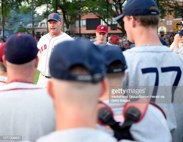 Roger Clemens talks with participants prior to the start of the 26th annual Oldtime Baseball Game at St. Peter's Field in Cambridge, Massachusetts on...