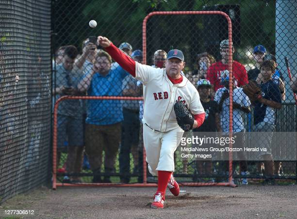 Roger Clemens warms up prior to the start of the 26th annual Oldtime Baseball Game at St. Peter's Field in Cambridge, Massachusetts on August 22,...