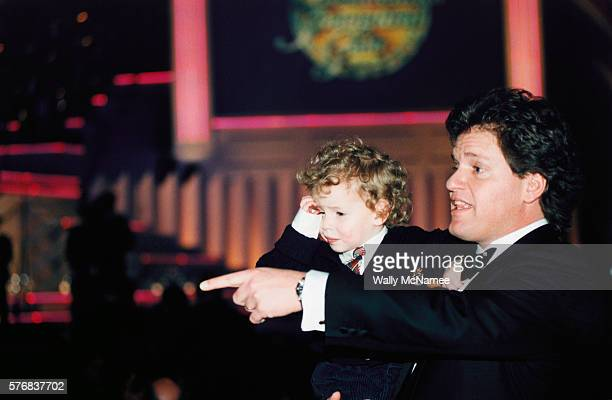 Roger Clinton halfbrother of President Bill Clinton holds his son Tyler at the Presidential Inaugural Gala