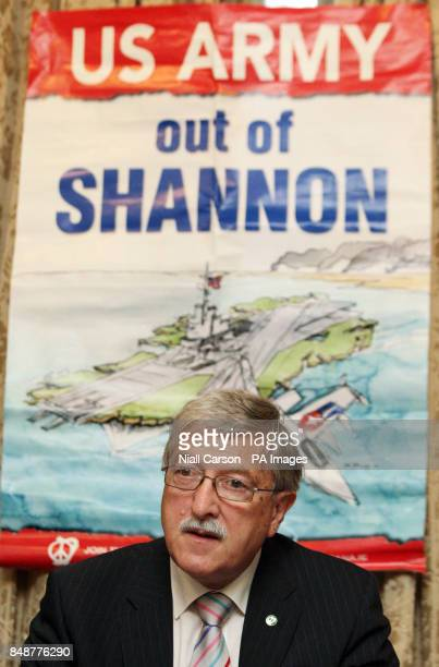 Roger Cole Chair of the Peace and Neutrality Alliance holds a pamphlet featuring President Michael D Higgins at the launch of the Shannon Airport War...