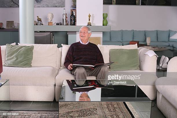 Roger Corman film producer director and actor poses for a portrait with the book Rock 'N' Roll Lens in his home in Los Angeles California on December...