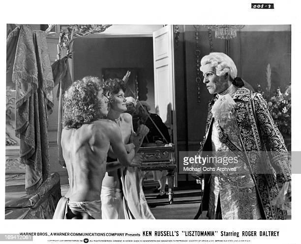 Roger Daltrey and Fiona Lewis are confronted by John Justin in a scene from the film 'Lisztomania', 1975.