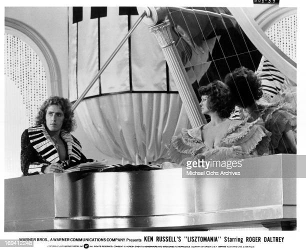 Roger Daltrey and Fiona Lewis at extravagant piano in a scene from the film 'Lisztomania', 1975.