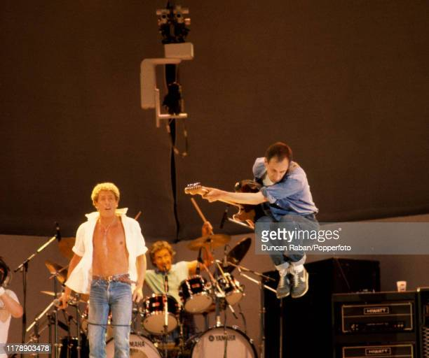 Roger Daltrey and Pete Townshend of The Who performing on stage during the Live Aid concert at Wembley Stadium in London England on July 13 1985 Live...