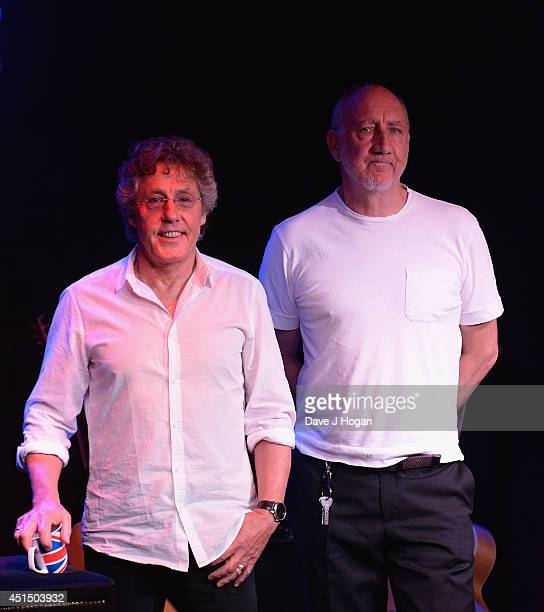 Roger Daltrey and Pete Townshend of The Who pose as they attend The 50th Anniversary Photocall of The Who at Ronnie Scott's on June 30 2014 in London...