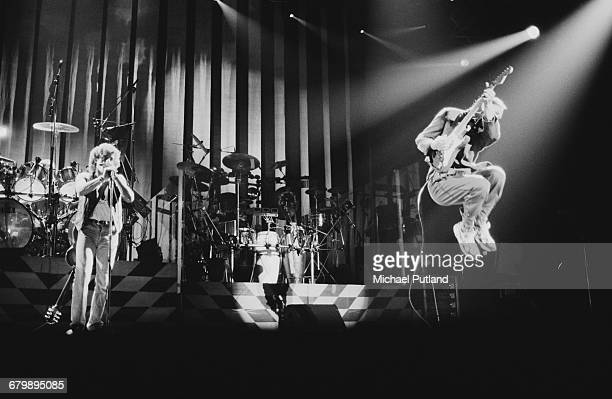 Roger Daltrey and Pete Townshend performing with The Who on stage in Birmingham 1989