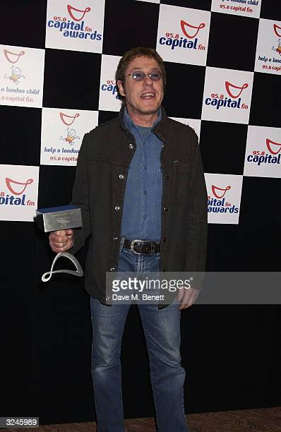 "Roger Daltrey poses in the awards room at the ""Capital FM Awards 2004"" at the Royal Lancaster Hotel on April 7, 2004 in London. The awards celebrate..."