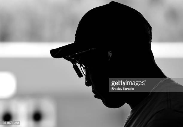 Roger Daniel of Trinidad and Tobago prepares to fire his gun in the qualification stages of the Men's 25m Rapid Fire Pistol event during Shooting on...