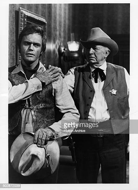 Roger Davis and Walter Brennan in a scene for the television movie of the week The Young Country circa 1970