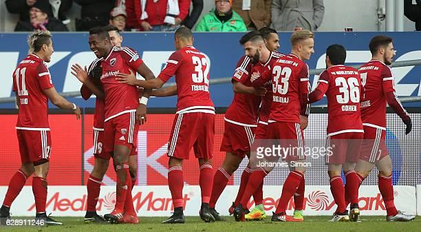 Roger de Oliveira Bernardo of Ingolstadt celebrates with team mates after scoring his team's first goal during the Bundesliga match between FC...