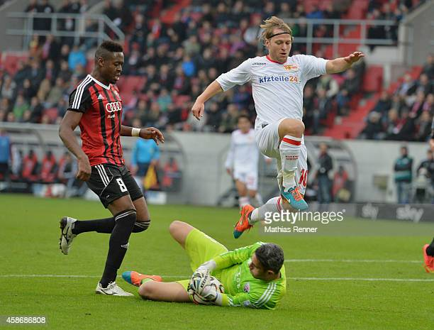 Roger de Oliviera Bernardo Ramazan Oezcan of FC Ingolstadt 04 and Martin Dausch of 1 FC Union Berlin in action during the game between FC Ingolstadt...