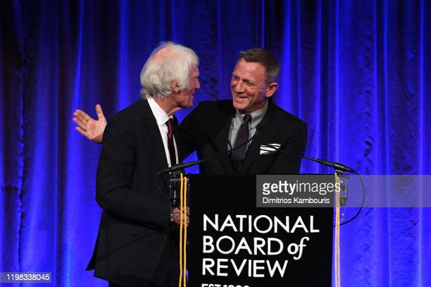 Roger Deakins accepts the award for Outstanding Achievement in Cinematography for 1917 from Daniel Craig onstage during The National Board of Review...