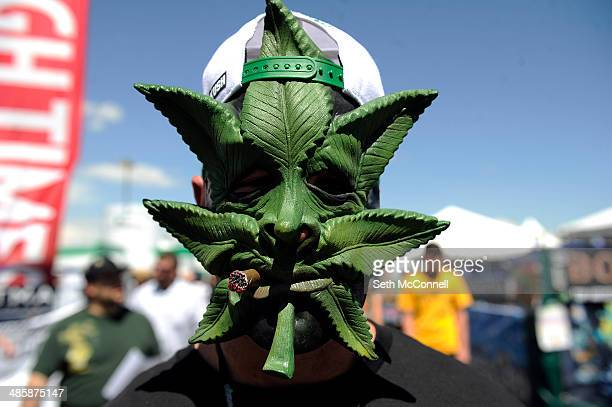 Roger Decker displays a marijuana mask during the High Times Cannabis Cup at Denver Mart in Denver Colorado on April 20 2014 Event organizers are...