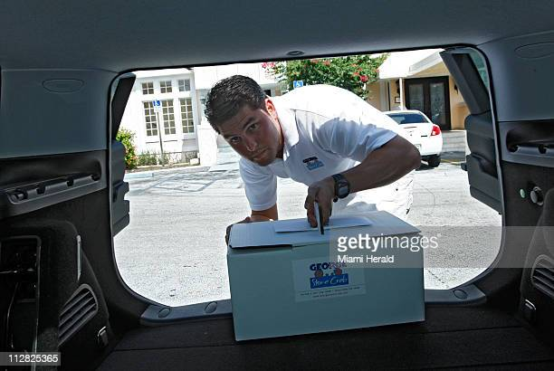 Roger Duarte dressed in white makes a delivery October 13 in Miami Florida Duarte is a former investment banker who last year switched careers into...