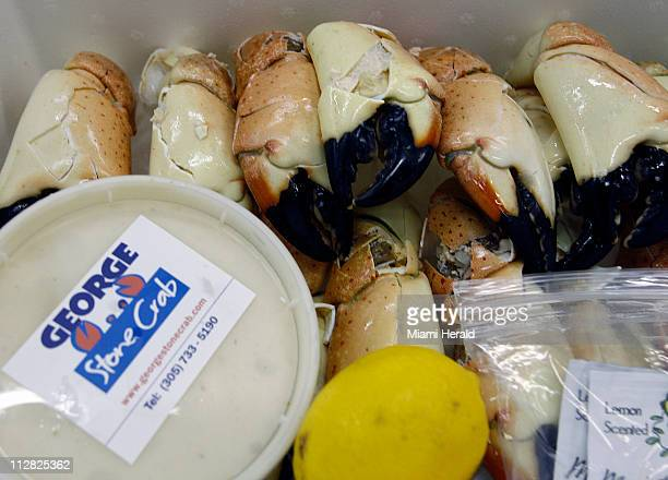 Roger Duarte prepares a 4lb box of stone crab for delivery October 13 in Miami Florida Duarte is a former investment banker who last year switched...