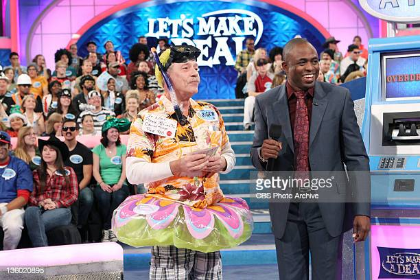 Roger E Gregg of Desert Hot Springs Calif pays close attention as host Wayne Brady explains the ATM game on a special crossover show between Let's...