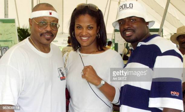 Roger E Mosley Laila Ali and husband Johnny Yahya McClain cE6 of Absollot Boxing inside the luncheon text at the Bob Beamon Golf and Tennis Classic
