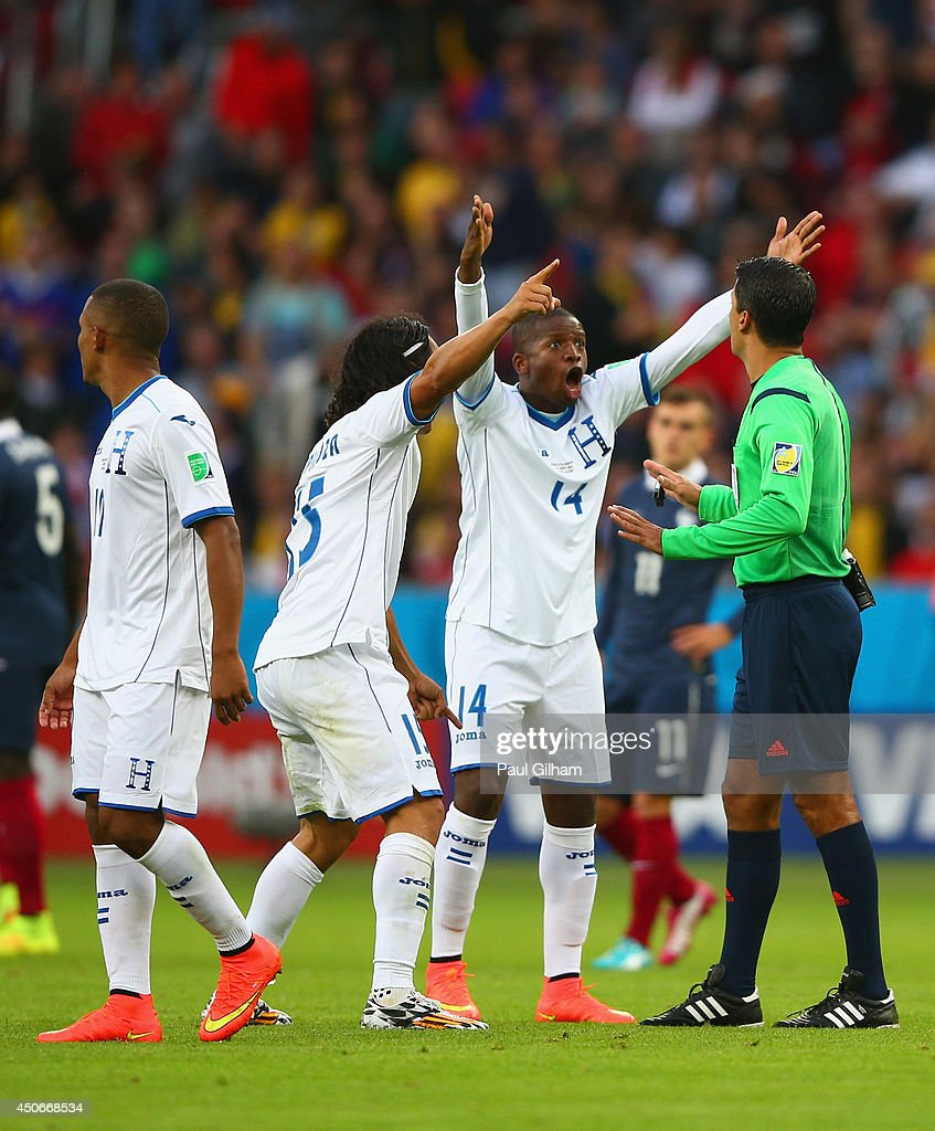 Roger Espinoza (2nd L) and Oscar Boniek Garcia of Honduras protest France's second goal with referee Sandro Ricci during the 2014 FIFA World Cup Brazil Group E match between France and Honduras at Estadio Beira-Rio on June 15, 2014 in Porto Alegre, Brazil.