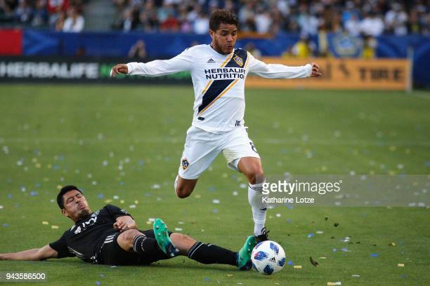 Roger Espinoza of Sporting Kansas City and Jonathan dos Santos of the Los Angeles Galaxy fight for control of the ball during a game at StubHub...
