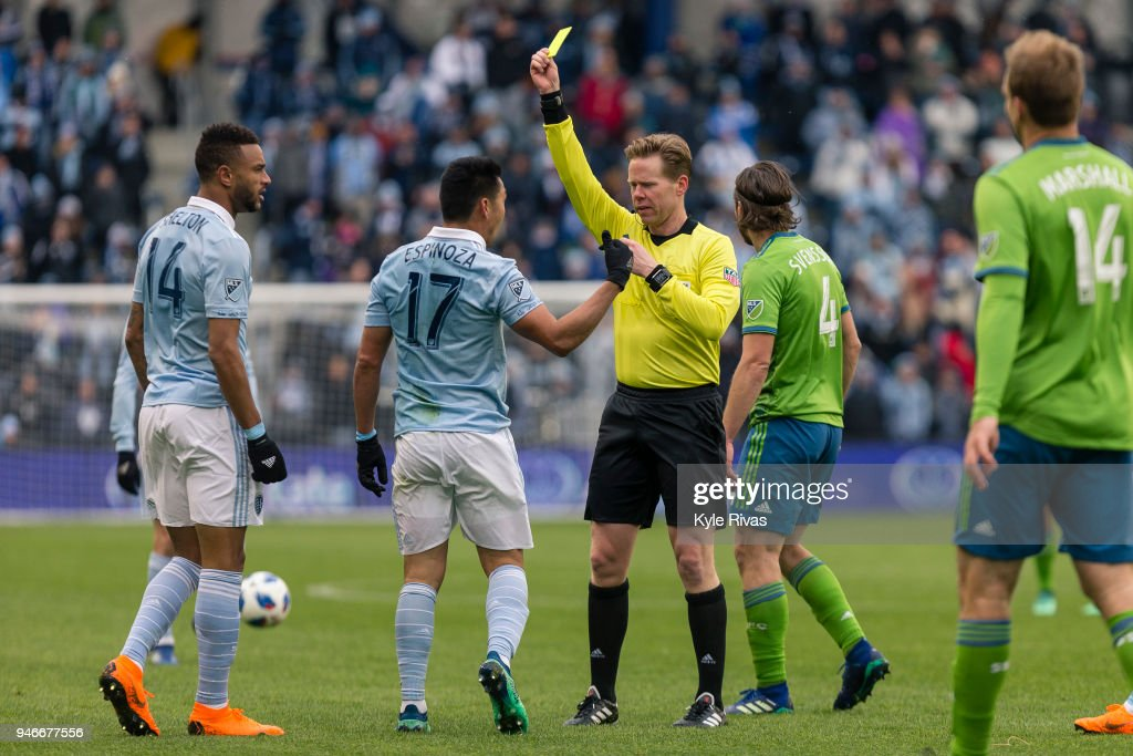 Roger Espinoza #17 of Sporting Kansas City argues with the referee after receiving a yellow card against the Seattle Sounders during the second half on April 15, 2018 at Children's Mercy Park in Kansas City, Kansas.