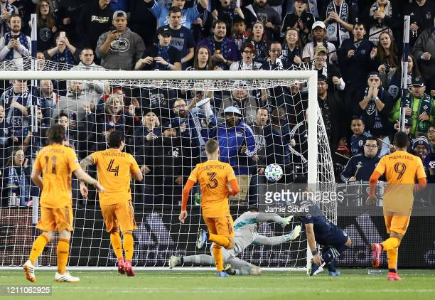 Roger Espinoza of Sporting Kansas City scores as goalkeeper Marko Maric of Houston Dynamo dives during the 1st half of the game at Children's Mercy...