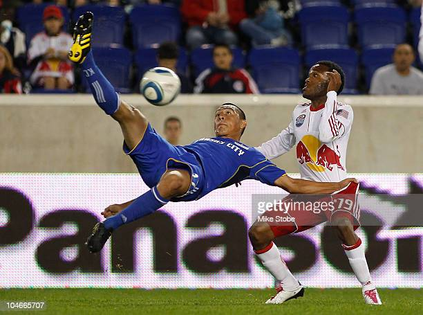 Roger Espinoza of the Kansas City Wizards challenges Dane Richards of the New York Red Bulls for the ball on October 2 2010 at Red Bull Arena in...