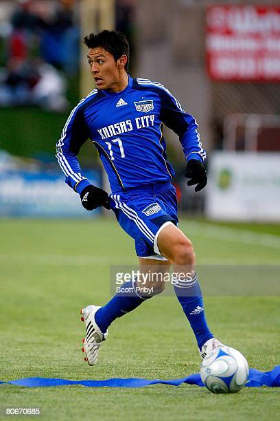 Roger Espinoza of the Kansas City Wizards dribbles against the Houston Dynamo during the game at Community America Ballpark on April 12, 2008 in...
