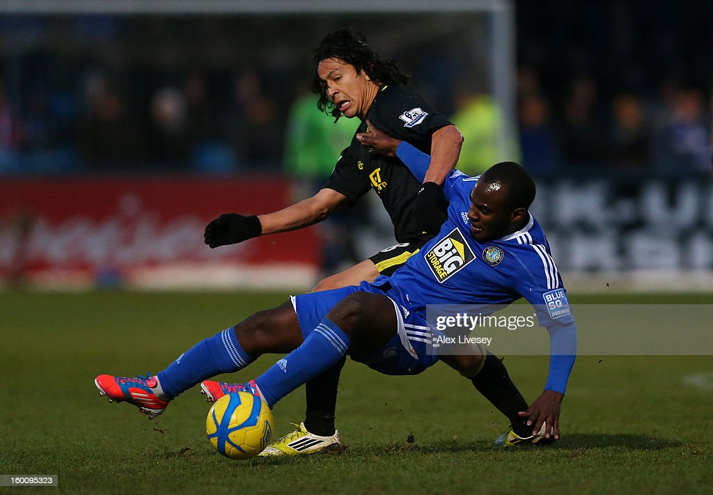 Roger Espinoza of Wigan Athletic clashes with Dean McDonald of Macclesfield Town during the Budweiser FA Cup fourth round match between Macclesfield Town and Wigan Athletic at Moss Rose Ground on January 26, 2013 in Macclesfield, England.