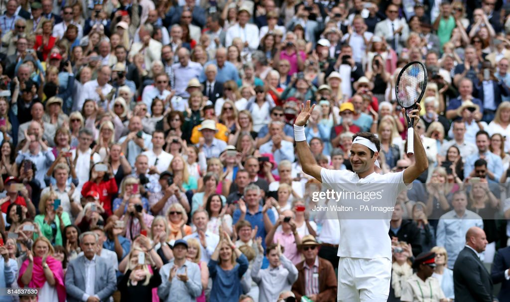 Roger Federer acknowledges the crowd after beating Tomas Berdych on day eleven of the Wimbledon Championships at The All England Lawn Tennis and Croquet Club, Wimbledon.