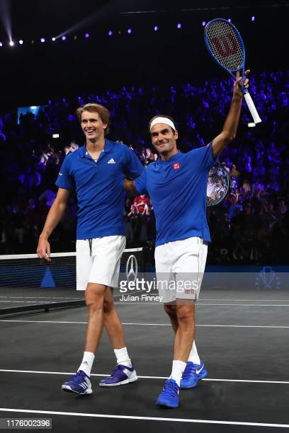Roger Federer and Alexander Zverev of Team Europe celebrate victory after their doubles match against Jack Sock and Denis Shapovalov of Team World...